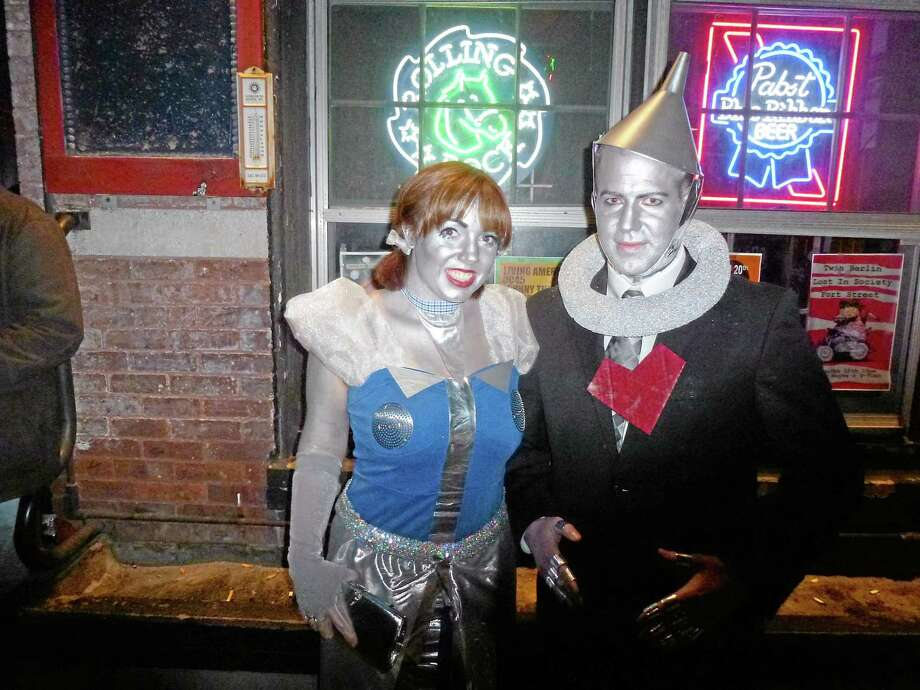 Jesse Sythe, dressed as a tinman, and Megan, a robot, were two of the attendees at the Robot Dance Party at Snapper Magee's for last year's robot dance-off. Photo: Register Citizen File Photo