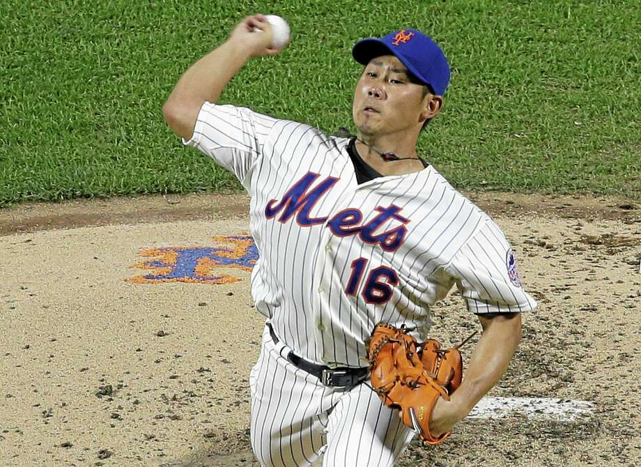 New York Mets' Daisuke Matsuzaka, of Japan, delivers a pitch during the fourth inning of a baseball game against the Detroit Tigers Friday, Aug. 23, 2013, in New York.  (AP Photo/Frank Franklin II) Photo: AP / AP