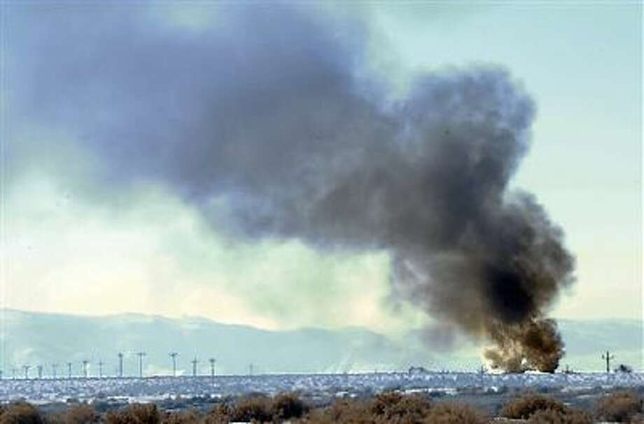 Smoke from the Bango Refining oil plant explosion Dec. 9 can be seen along U.S. 50 alternate between Fernley and Fallon, Nev. The fire critically injured a 24-year-old refinery worker. Photo: AP / The Reno Gazette-Journal