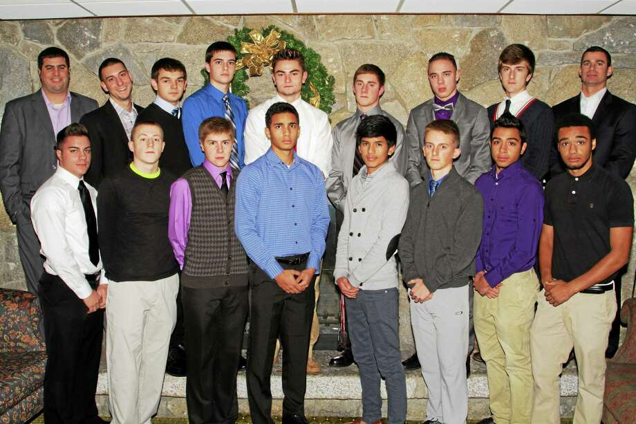 Torrington boys soccer seniors and coaches pose for photos during Thursday's banquet. Front Row from left: John Thebarge, Collin Genovese, Mitchell Canty, Jose Peguero, Kevin Vaca, Nick Sparks, Michael DeSousa, Keyon Robinson. Back Row from left: Head Coach Michael C. Fritch, Assistant Coach Kevin Poniatoski, Luke Calabrese, Ryan Casper, Amar Suljic, Alex Church, Ethan Barbieri, Tom Killackey, Goalie Coach Jason Apruzzese. Photo: Marianne Killackey — Special To Register Citizen  / 2014