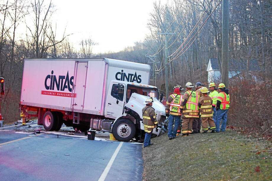 Firefighters at the scene of a fatal accident on Route 44 in Norfolk involving a box truck and sports-utility vehicle. The SUV's driver was killed. Photo: Mercy Quaye — Register Citizen