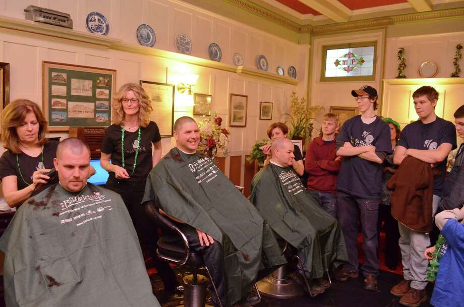 Members of the Torrington Fire Department and Police Department shaved their heads for childhood cancer research the 2013 St. Baldrick's event. Photo: Register Citizen File Photo