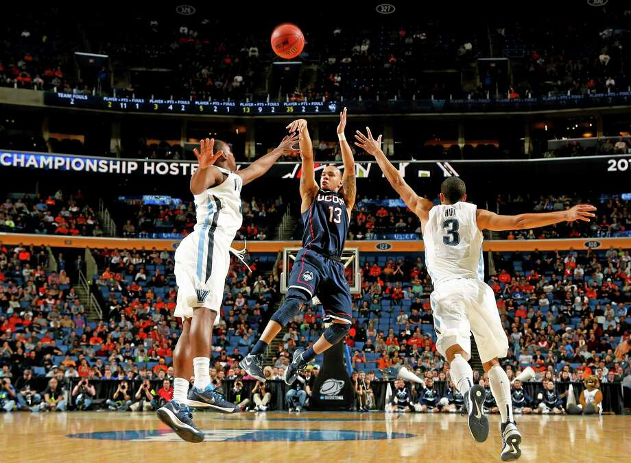 Shabazz Napier hit three straight 3-pointers late in the second half to propel UConn to a 77-65 win over Villanova in the third round of the NCAA tournament on Saturday night in Buffalo, N.Y. Photo: Bill Wippert — The Associated Press  / FR170745 AP