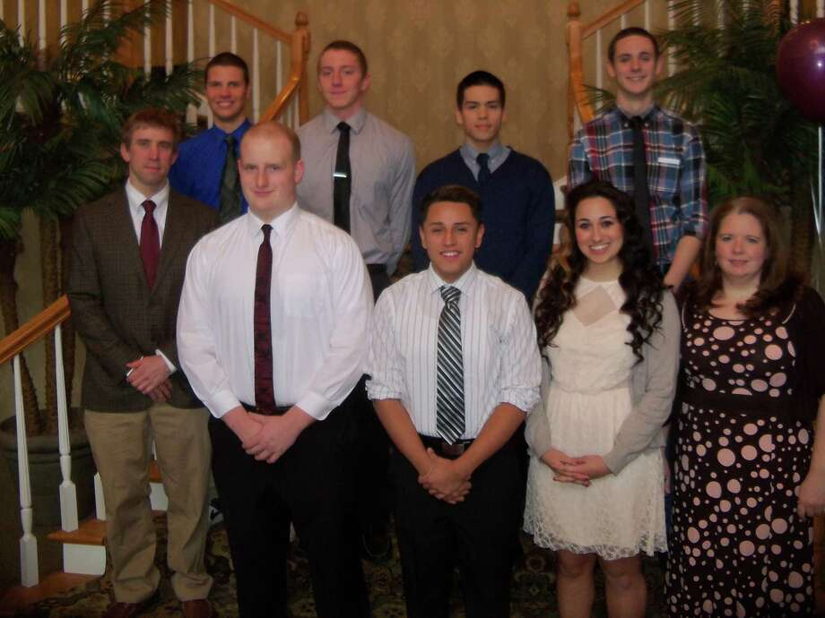 Torrington High School swimming and diving team coaches and seniors at Sunday's year-end banquet are, front row, left to right: head coach Andrew Marchand, Ernie Tracy, Carlos Bravo, Salma Malik, assistant coach Erin Sullivan. Second row, left to right: Chris Parrotta, Dave Cilfone, co-captain Brad Nichols, co-captain Griffin Pelkey. Photo: Peter Wallace — Register Citizen