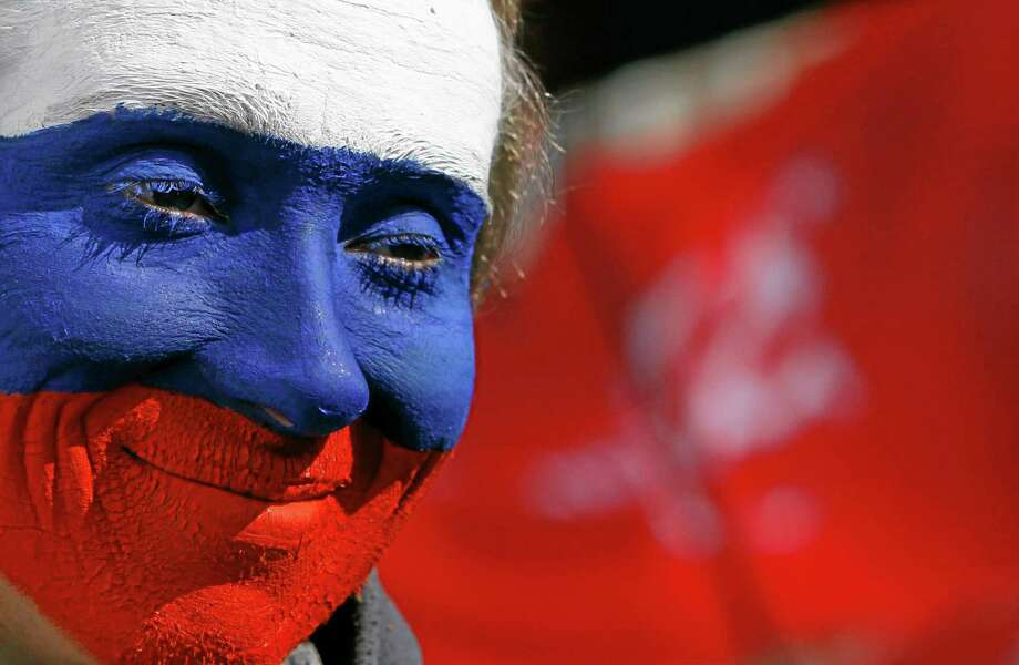 A pro Russian activist with his face painted in the colors of the Russian flag attends rally at a central square in Donetsk, eastern Ukraine, Saturday, March 22, 2014. More than 5,000 pro-Russia residents of this major city in Ukraine's east have been demonstrating in favor of holding a referendum on secession. The rally in Donetsk comes less than a week after voters in Crimea approved a similar referendum and Russia formally annexed the territory. (AP Photo/Sergei Grits) Photo: AP / AP