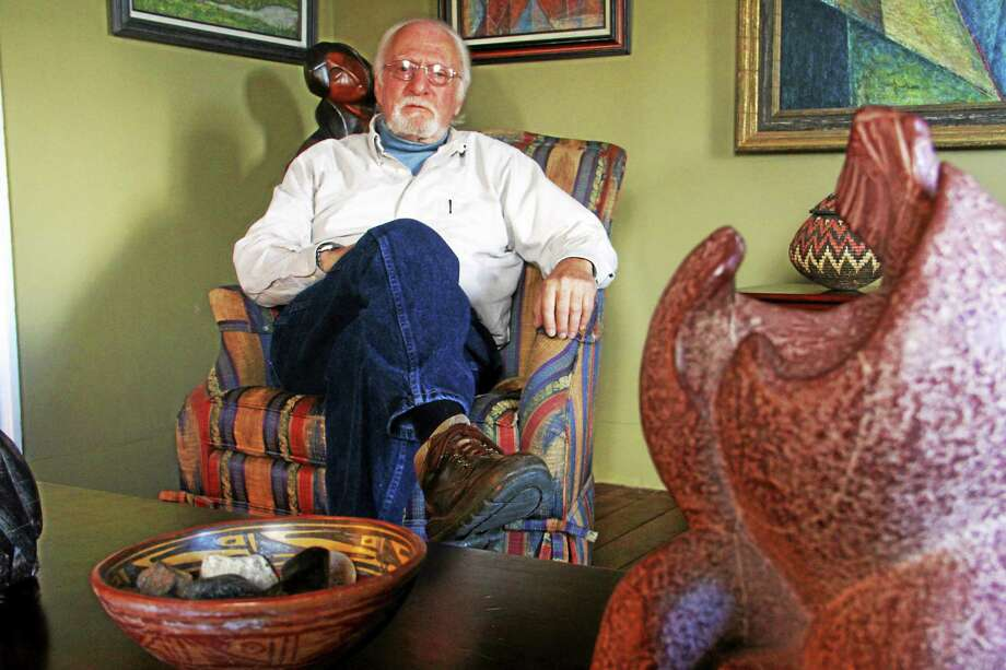 Artist Ed Jaffe, surrounded by his paintings and sculptures in his Torrington home, is in favor of a proposed zoning changes making it easier for local artists to do their creative work in their own homes. Photo: Esteban L. Hernandez — The Register Citizen