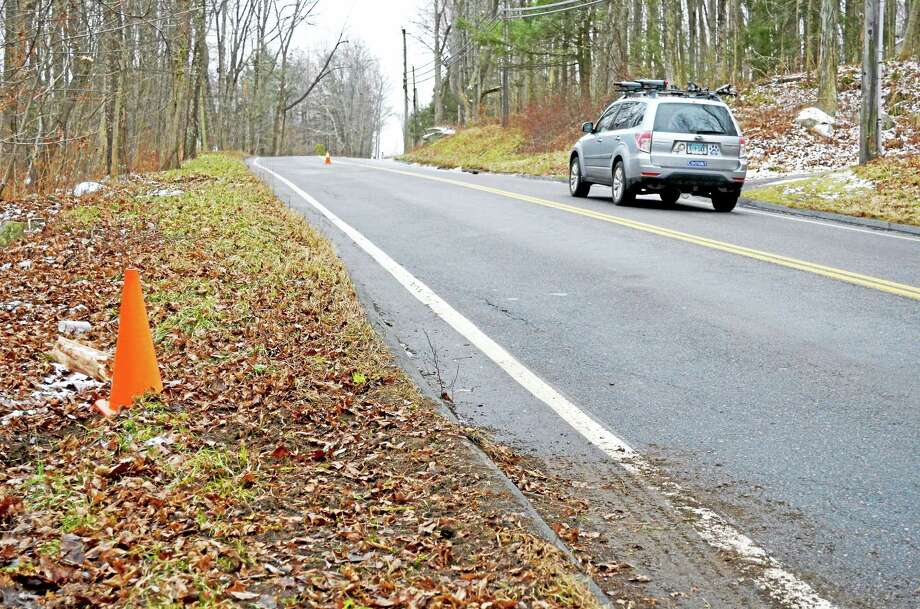This section of Torringford Road in Torrington was the scene of a fatal one-car crash early Sunday morning. Photo: John Berry - The Register Citizen