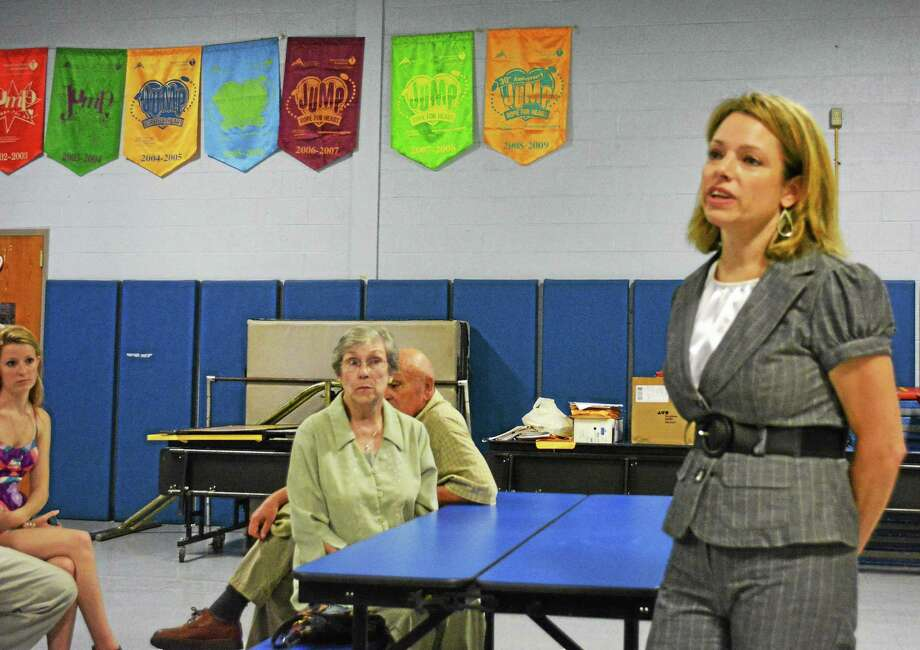 Barbara Silverio, the new principal of Pearson School, right, addresses the Winchester Board of Education Tuesday evening. Photo: Ryan Flynn — The Register Citizen