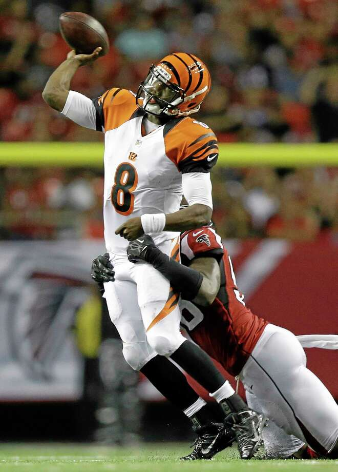 Cincinnati Bengals quarterback Josh Johnson (8) passes the ball under pressure from Atlanta Falcons defensive end Jonathan Massaquoi (96) during the second half of a preseason NFL football game, Thursday, Aug. 8, 2013, in Atlanta.  (AP Photo/David Goldman) Photo: AP / AP