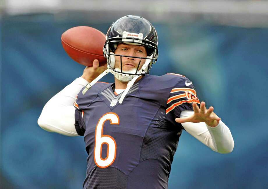 Chicago Bears quarterback Jay Cutler (6) warms up before a preseason NFL football game against the San Diego Chargers, Thursday, Aug. 15, 2013, in Chicago. (AP Photo/Jim Prisching) Photo: AP / FR59933 AP