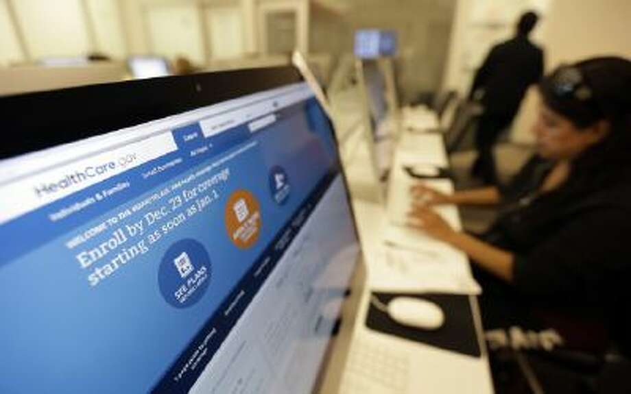 Rosemary Cabelo uses a computer at a public library on Dec. 11 to access the Affordable Health Care Act website, in San Antonio.