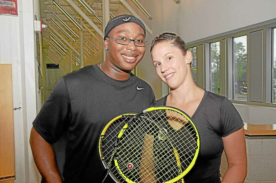 The husband and wife team of Raymond and Colleen Green were the runner-ups in the Family Classic Thursday at Yale. The Middletown couple were representing the Manchester Racquet Club. Photo: Bill O'Brien—Special To The Middletown Press