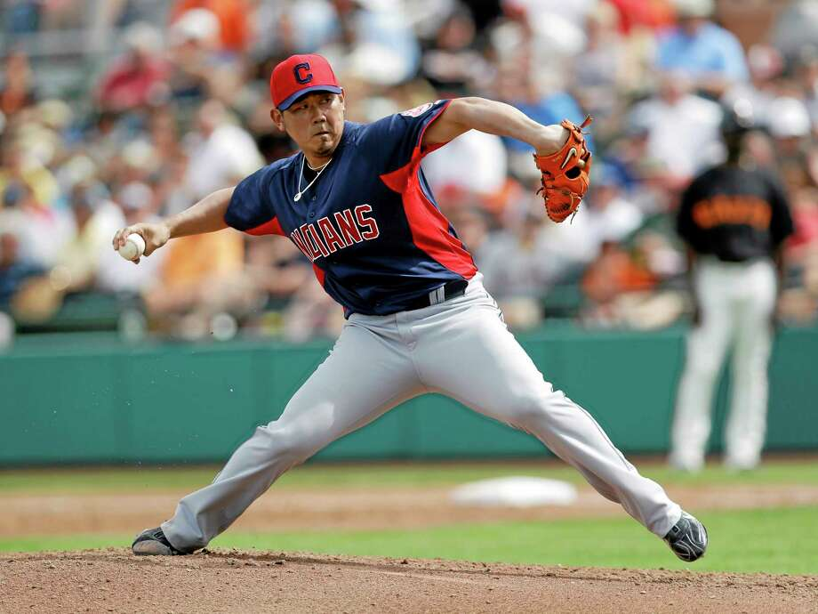 FILE - In this March 5, 2013 file photo, Cleveland Indians starting pitcher Daisuke Matsuzaka throws against the San Francisco Giants during the second inning of a spring training baseball game in Scottsdale, Ariz. The Indians have released Matsuzaka. He is now a free agent. (AP Photo/Marcio Jose Sanchez, File) Photo: AP / AP