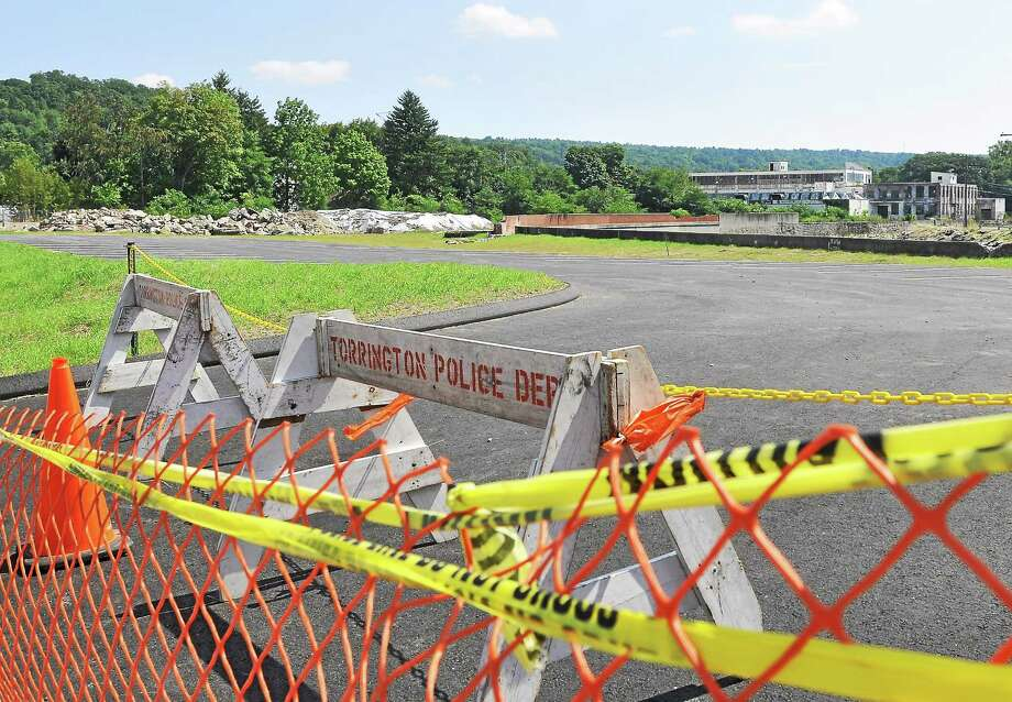 A brownfield site on Franklin Street as seen Wednesday in Torrington. The city has been working to remediate the site and has turned a portion of property into new parking spaces. Photo: Tom Caprood — The Register Citizen