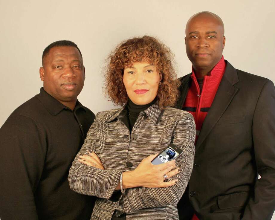 """Creators of the """"Driving While Black"""" app in Portland, Ore., from left, software developer James Pritchett, lawyers Mariann Hyland and Melvin Oden-Orr. Hyland and Oden-Orr plan to release the free app that educates people how to safely deal with police during traffic stops and will provide common sense advice to people of all races and outlines about their civil rights during a stop. Photo: AP Photo/Driving While Black  / DRIVING WHILE BLACK"""