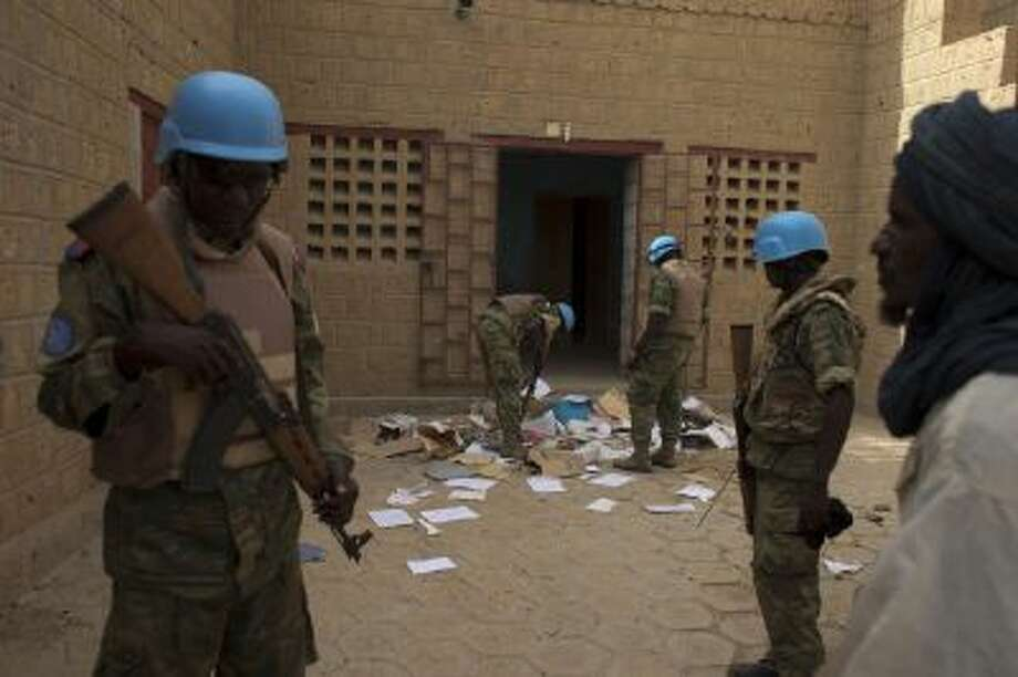 In this July 23, 2013 file photo, United Nations peacekeepers search a house suspected to have been used by members of al-Qaida's North African branch in Timbuktu, Mali.