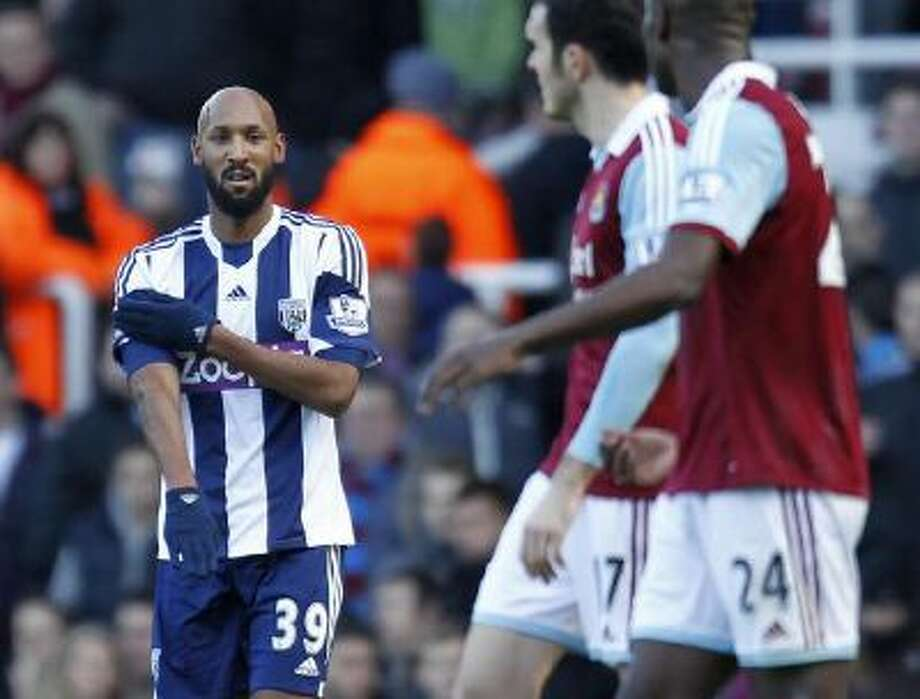 West Bromwich Albion's French striker Nicolas Anelka gestures as he celebrates scoring their second goal during the English Premier League football match between West Ham United and West Bromwich Albion.
