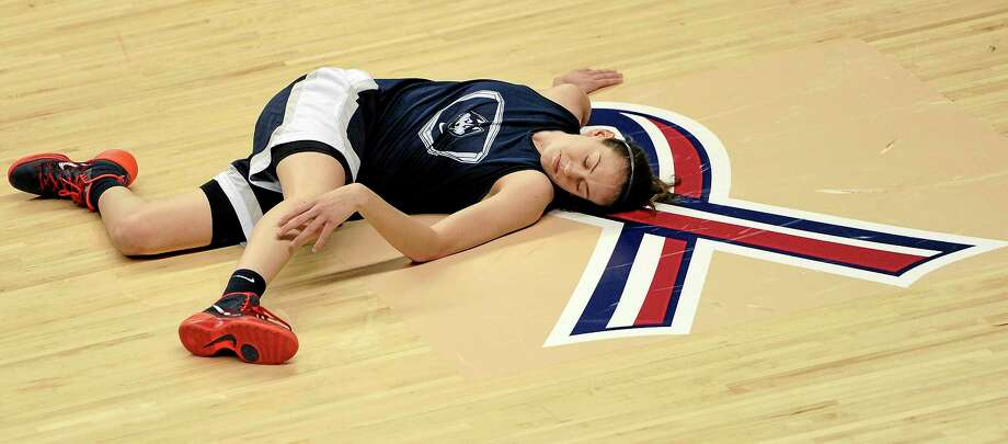 Breanna Stewart stretches during practice at Gampel Pavilion in Storrs on Saturday. UConn takes on Prarie View A&M in an NCAA tournament first-round game on Sunday. Photo: Jessica Hill — The Associated Press  / FR125654 AP
