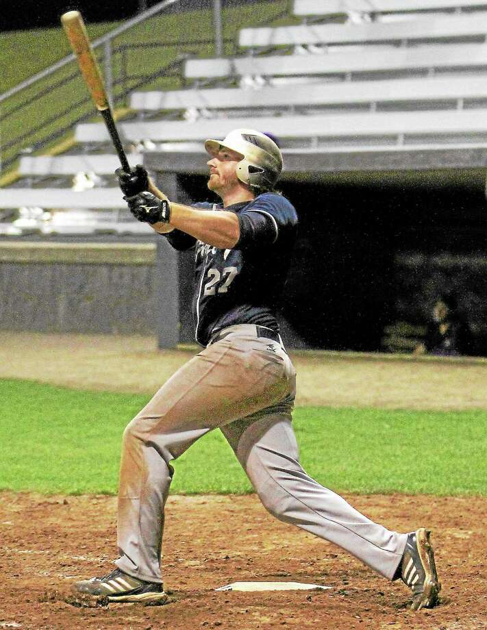 Naugatuck's Kyle Murphy watches the ball sail over the fence as he slams a three-run homer to tie the game in the bottom of the 7th inning. Photo: Marianne Killackey—Special To The Register Citizen  / 2013