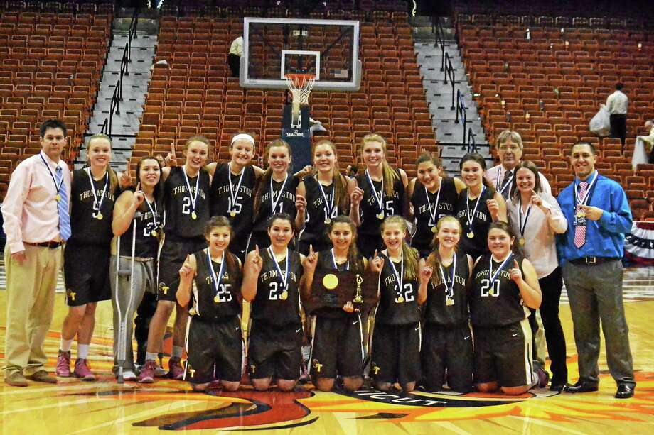 Pete Paguaga - Register Citizen The Thomaston Golden Bears pose with the Class S Championship plaque after defeating St. Paul 61-57 in double overtime. This is Thomaston first girls basketball State championship since 1993. Abby Hurlbert hit three-free throws with 0.2 seconds left in the first overtime to tie the game and send it to the second overtime. It was the second game in CIAC State Tournament history to go to two overtimes. Photo: Journal Register Co.