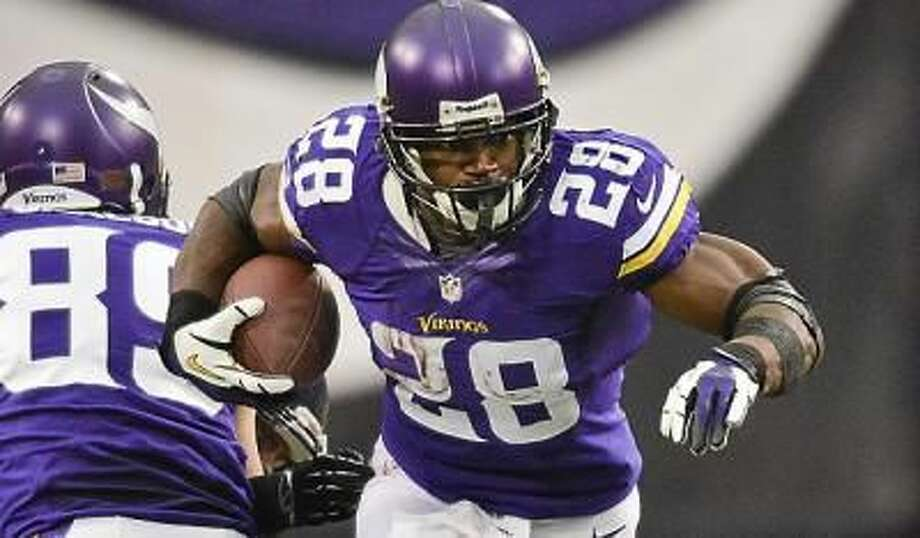 Vikings running back Adrian Peterson takes the ball for a first down in the second quarter against the Bears at the Metrodome in Minneapolis on Sunday, December 1, 2013. Peterson passed the career 10,000-yard mark during the game. Photo: Ben Garvin