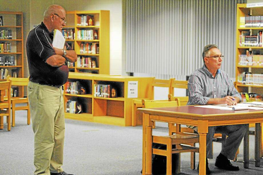 Mike McKenna, left, presented the draft athletic department handbook to the board of education. Board member Paul Cavagnero criticized the policy for not going far enough. Photo: Jessica Glenza—Register Citizen