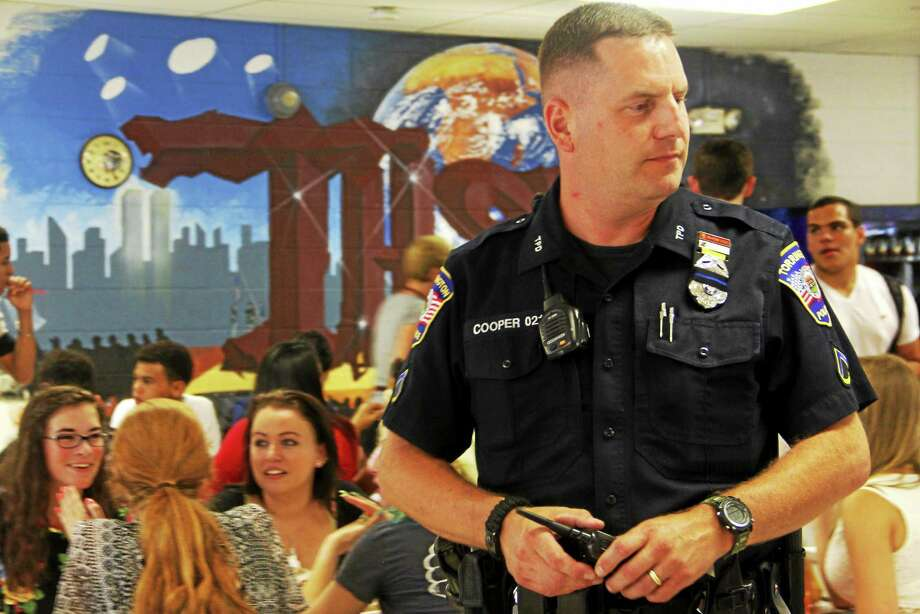 Torrington High School's new School Resource Officer David Cooper, of the Torrington Police Department, inside the school's cafeteria Wednesday in Torrington. Wednesday was the first school day of the year for the district and Cooper's first day on the job. Photo: Esteban L. Hernandez — The Register Citizen