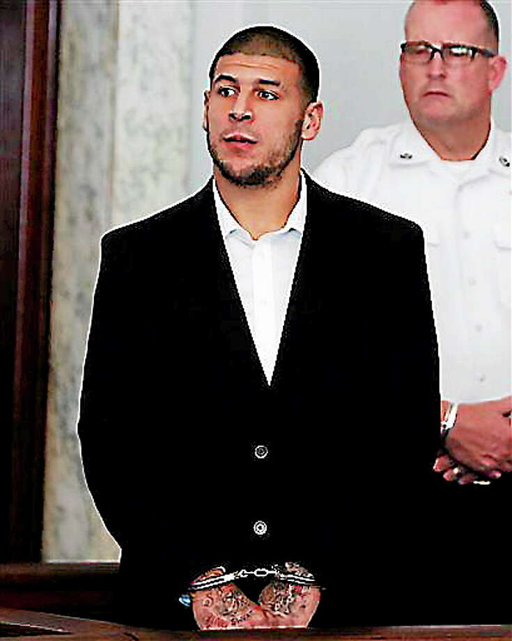 Former New England Patriots NFL football tight end Aaron Hernandez appears at Attleboro District Court on Wednesday, July 24, 2013, in Attleboro, Mass. Hernandez has pleaded not guilty to murder in the death of Odin Lloyd. Hernandez was in court for what was supposed to be a probable cause hearing, but prosecutors said the grand jury is still considering the evidence against him. A judge rescheduled the probable cause hearing for Aug. 22, after considering defense objections to a delay. (AP Photo/Bizuayehu Tesfaye) Photo: AP / FR30253 AP