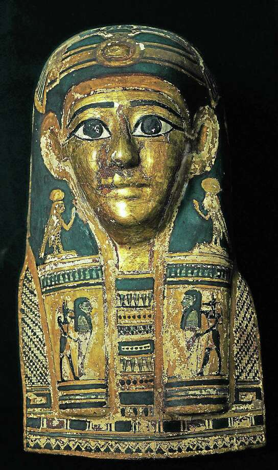 "Gilded mummy mask from ""Echoes of Egypt."" Photo: W. Sacco"