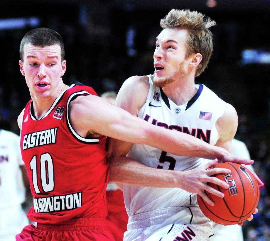 Arnold Gold — Register  UConn's Niels Giffey, right, is fouled by Eastern Washington's Parker Kelly during Saturday's game in Bridgeport. Photo: Journal Register Co.