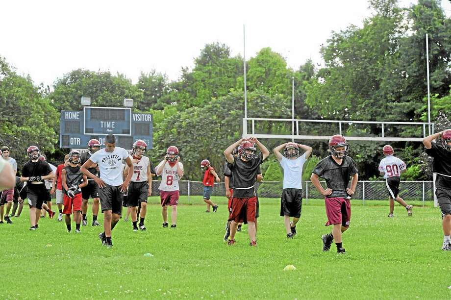 Torrington Red Raider football team members practice on the high school's football field, a $2.7 million renovation of which has become controversial. Photo: Register Citizen FILE PHOTO