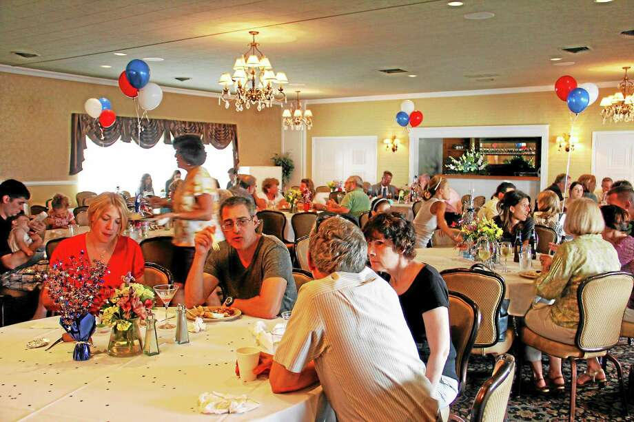 People dine and mingle on Thursday, Aug. 22, during the Democratic Town Committee's fundraising picnic at P. Sam's Bar & Grille at the Eastwood Country Club. Nearly 150 people were in attendance throughout the about three-hour event, Photo: Esteban L. Hernandez—Register Citizen