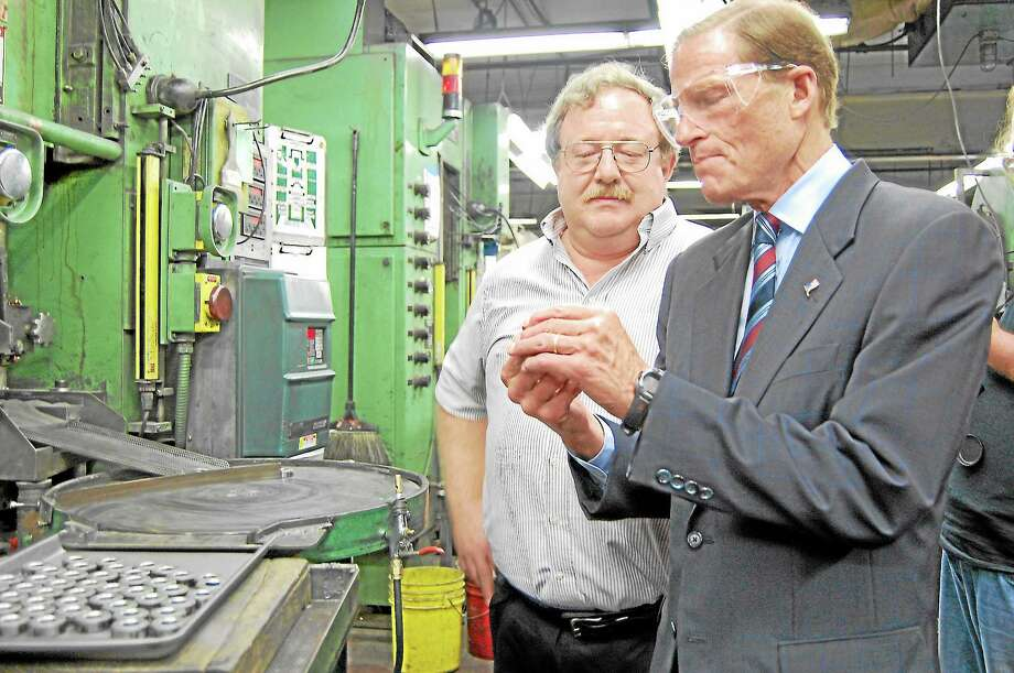Sen. Richard Blumenthal tours Sterling Sintered Technologies with Quality Engineer John Bartram in Winsted on Thursday, Aug. 22. Photo: Mercy Quaye—Register Citizen