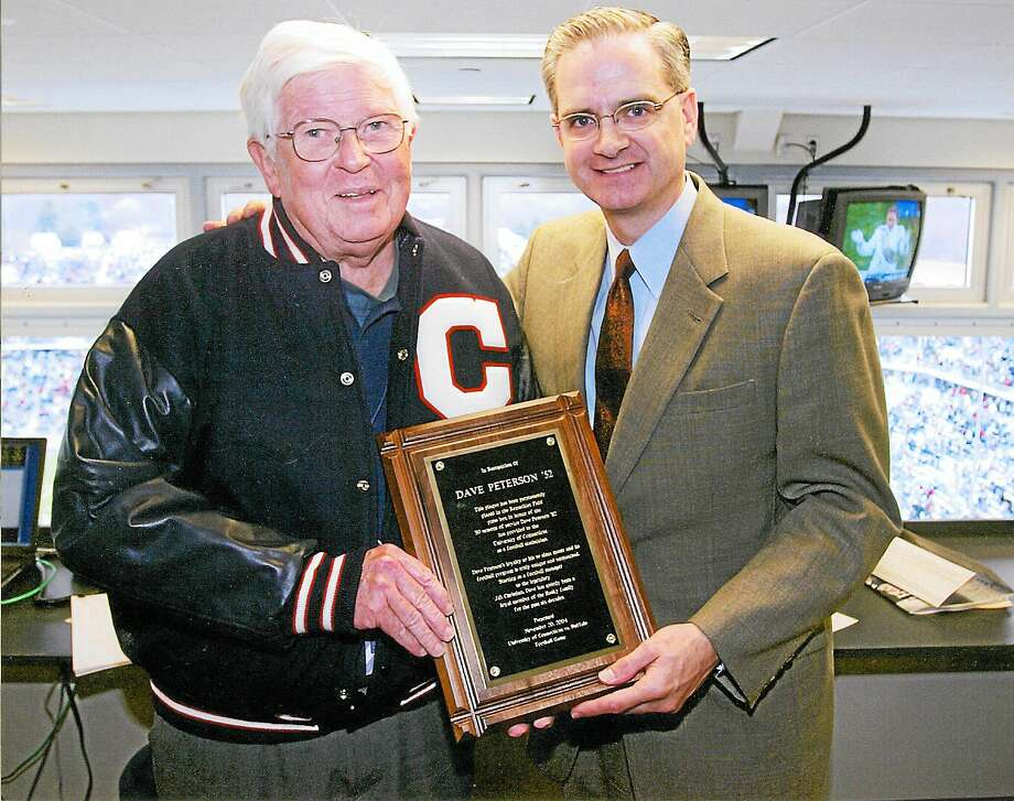 Wallingford's Dave Peterson, left, poses with former UConn athletic director Jeff Hathaway. Peterson has been statistician for the Huskies' football team for 60 seasons. Photo: Photo Courtesy Of UConn Athletics