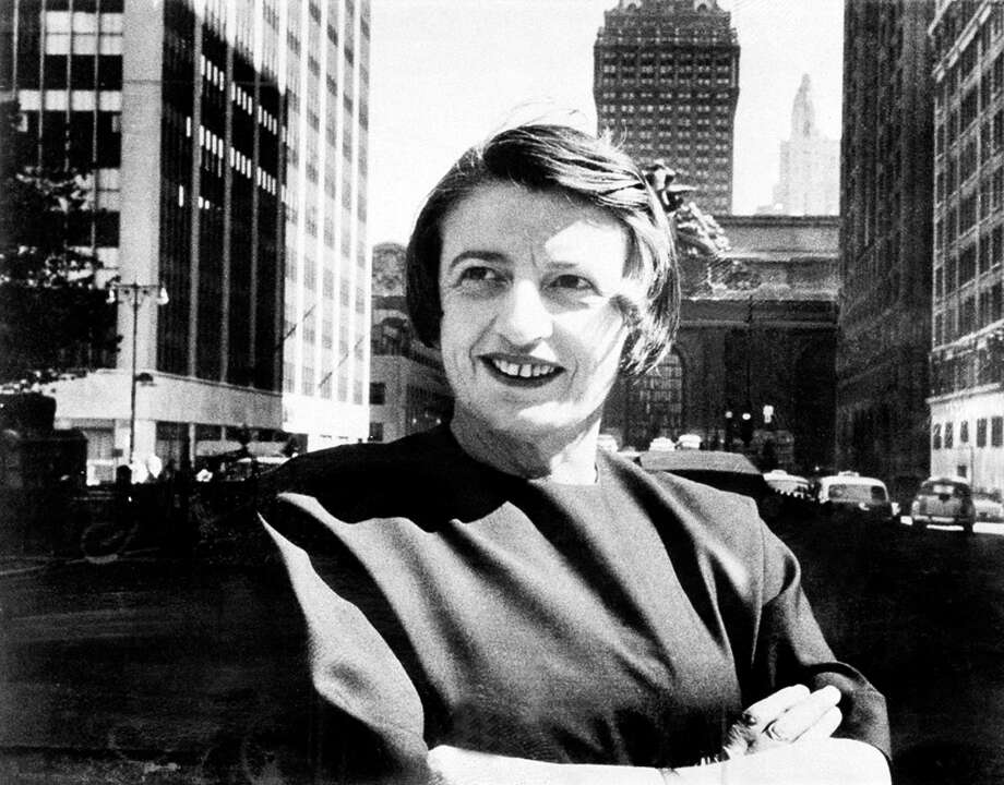 """FILE - This 1962 file photo Ayn Rand, Russian-born American novelist, is photographed in New York with Grand Central Terminal in the background.  A Rand novel written, temporary shelved and later published as a play is finally being released in its original form. The New American Library, an imprint of Penguin Random House, announced Thursday, Dec. 4, 2014,  that Rand's """"Ideal"""" would be published July 7.  (AP Photo) Photo: AP / AP"""
