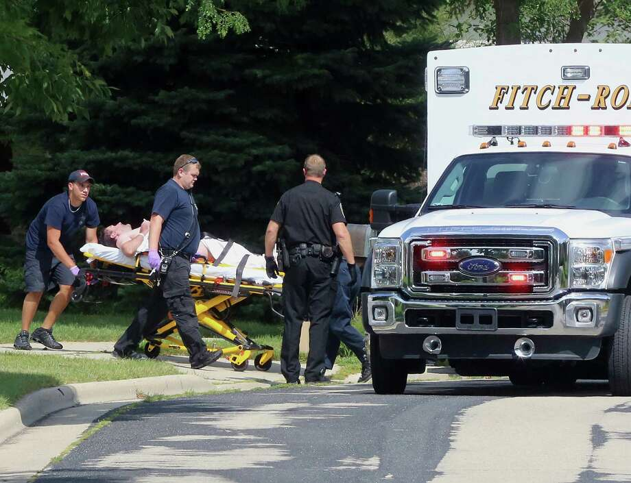 FILE - In this Aug. 22, 2014 file photo emergency personnel transport Andy Steele from his home in Fitchburg, Wis., where authorities said Steele's wife, Ashlee Steele and sister-in-law, Kacee Tollesfsbol, were found shot dead. Authorities said Tuesday, Aug. 26, 2014 that Tollefsbol called 911 around 1 p.m. Friday and said Andy Steele had shot her in the back. Andy Steele was arrested but hasn't been charged. (AP Photo/Wisconsin State Journal, John Hart, File) Photo: AP / Wisconsin State Journal