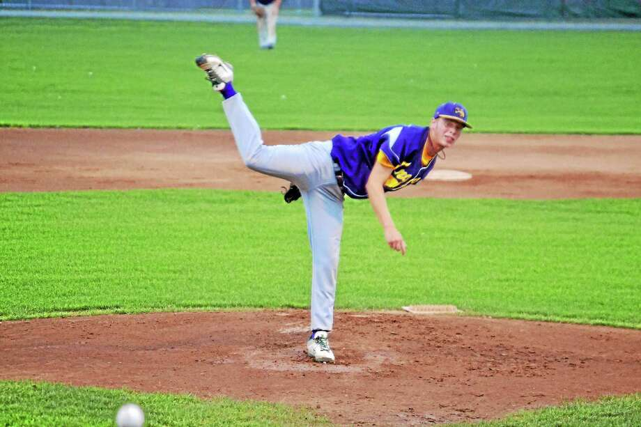 Miles Scribner of the Tri-Town Trojans shut out the Naugatuck Dogs in the Trojans 2-0 win. Scribner allowed six hits and struck out eight. Photo: Pete Paguaga—Register Citizen