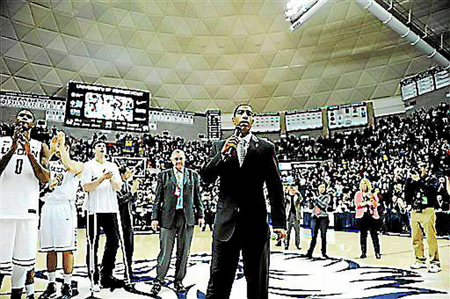 Connecticut coach Kevin Ollie speaks with fans after his team's 63-59 overtime win against Providence in an NCAA college basketball game in Storrs, Conn., Saturday, March 9, 2013. (AP Photo/Fred Beckham) Photo: AP / FR153656 AP