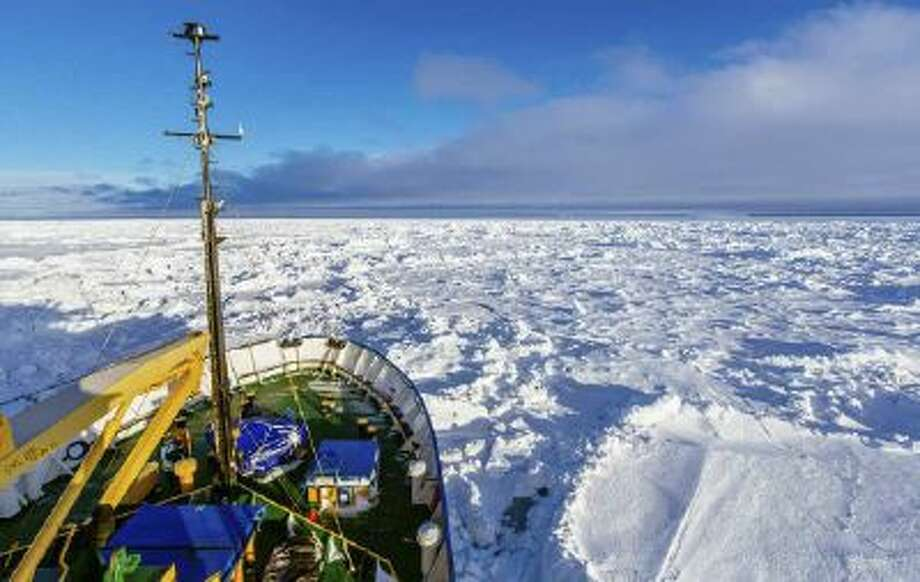 In this image provided by Australasian Antarctic Expedition/Footloose Fotography the Russian ship MV Akademik Shokalskiy is trapped in thick Antarctic ice 1,500 nautical miles south of Hobart, Australia, Friday.