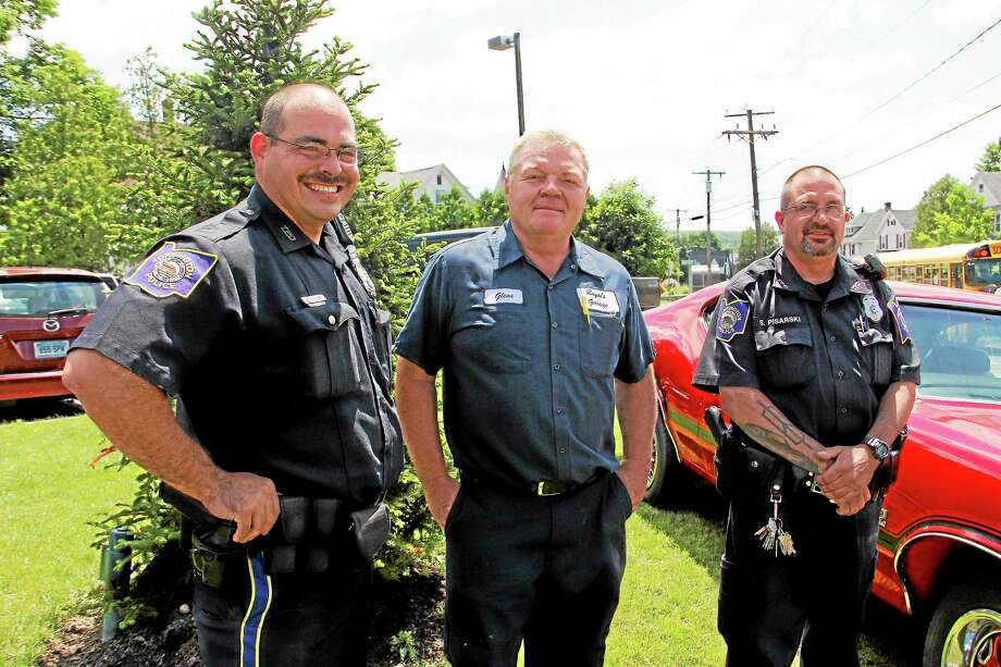 From left: Officer Steven Cloutier, Glenn Royals and officer Steve Pisarski stand outside the Torrington Police Department on Wednesday, June 19, 2013. The three men are helping organize the Torrington Police Department Auto Show, which will take place on Friday starting at 5:30 p.m. on Main Street in Downtown. More than 300 cars are expected. Esteban L. Hernandez Register Citizen Photo: Journal Register Co.