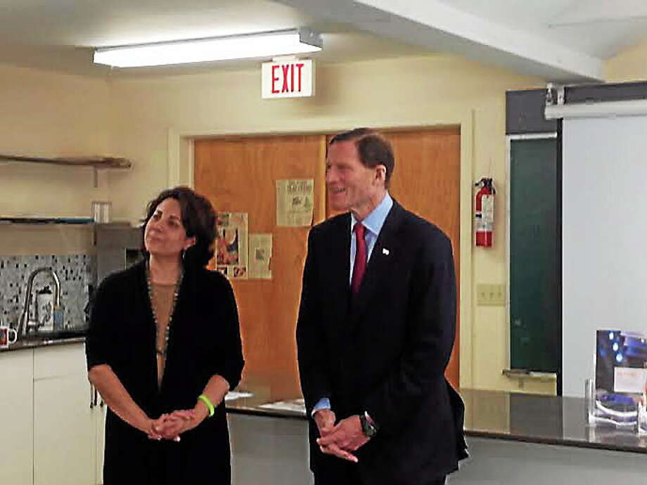 U.S. Sen. Richard Blumenthal, D-Conn., meets with Lyme disease researchers and awareness advocates at Common Ground High School. Dr. Joann Petrini, director of the Lyme Disease Registry and clinical research at Danbury Hospital, listens to other advocates with Blumenthal. Photo: Journal Register Co.