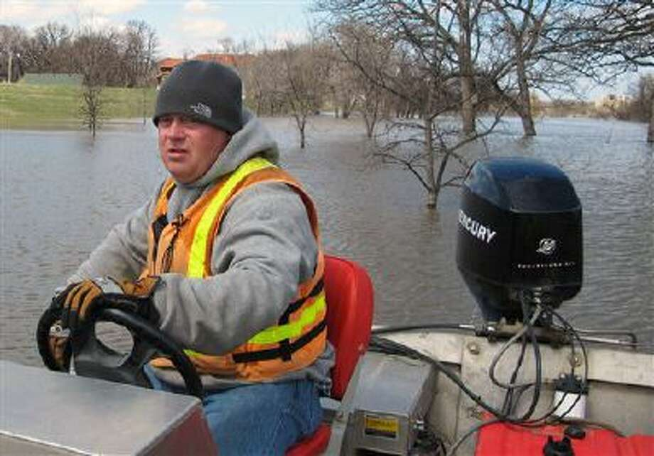 An official from the US Geological Survey works on the Red River on Fargo, N.D., in April. Water projects could be back on the table for Congress. Photo: AP / AP