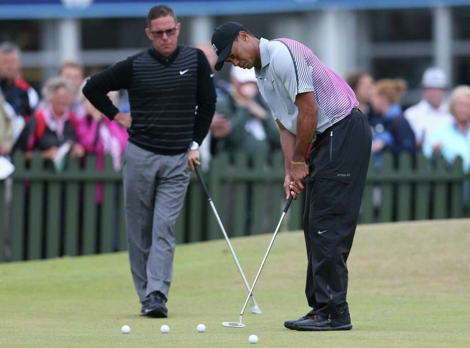 Tiger Woods is leaving swing coach Sean Foley after four years and no majors. Photo: Scott Heppell — The Associated Press File Photo  / AP