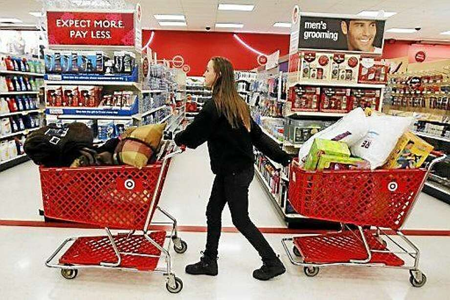 A woman pulls two shopping carts through the Torrington Target store. Police are investigating the theft of iPads from the East Main Street store during a burglary Wednesday afternoon. Photo: (Screenshot Via Vosizneias.com)