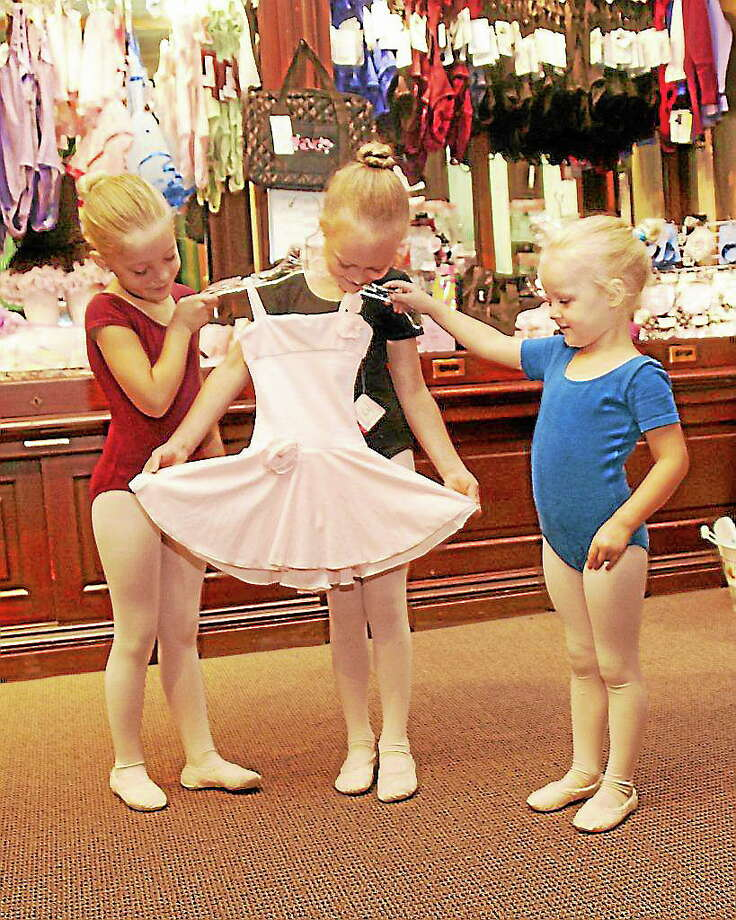 Submitted photo - Nutmeg Students from Pre-Ballet Grades 1 and 2 enjoy the one-stop Dance Shop while they register for the TSOB fall program. Photo: Journal Register Co.