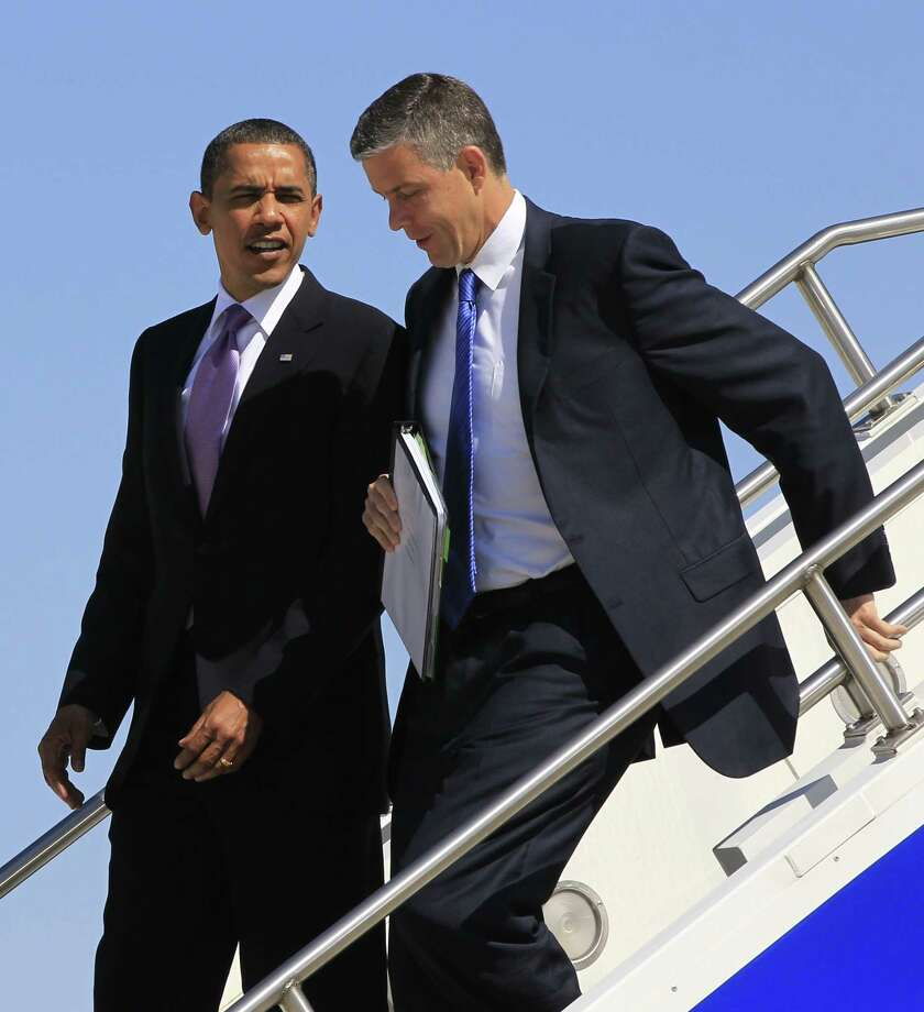 This June 7, 2010 photo shows President Barack Obama and Education Secretary Arne Duncan, as they step off Air Force One at Gerald R. Ford International Airport in Grand Rapids, Mich. Photo: AP Photo/Charles Dharapak, File  / AP