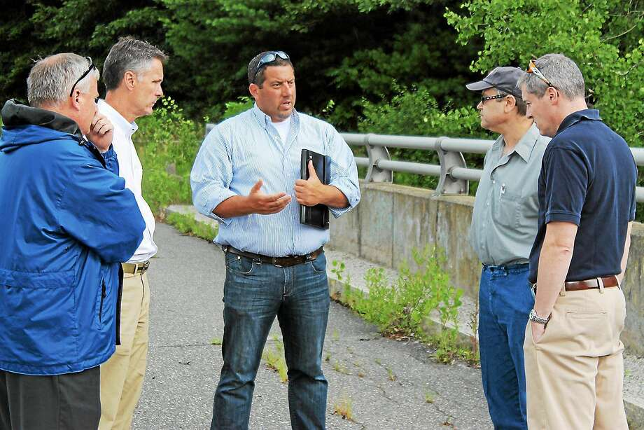 State Rep. Jay Case (Center) met with Dale Martin, Neil Amwake and DEEP Officials to find a solution to the crumbling infrastructure of town dams. Photo: Register Citizen File Photo