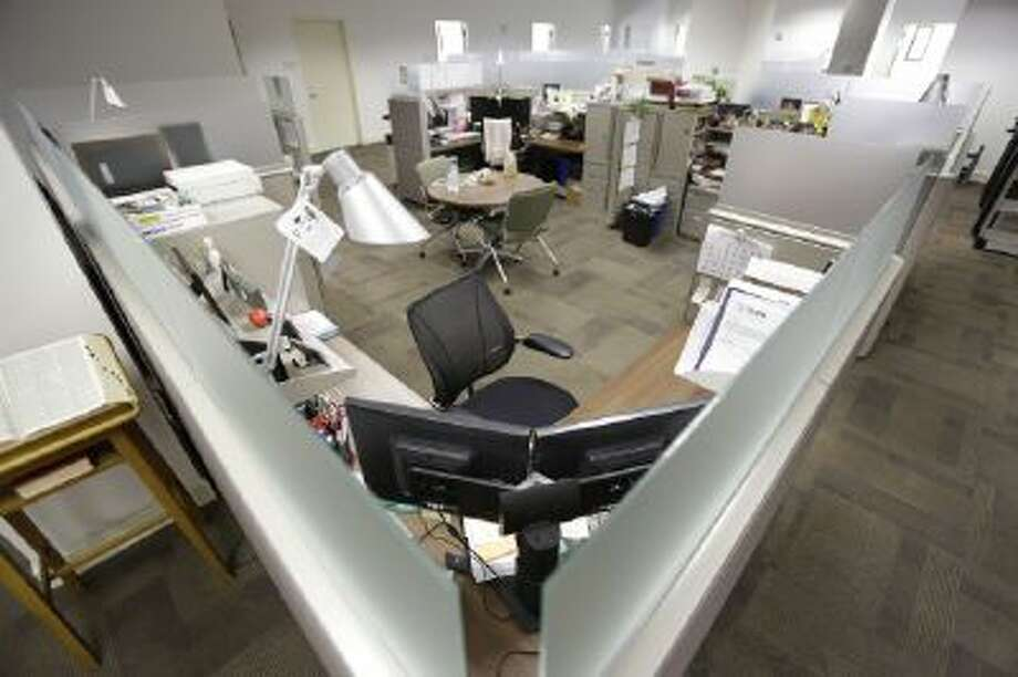 Chairs and cubicles are empty at the U.S. Army Garrison Ft. Lee Management Services budget office in Petersburg, Va., during the government shutdown in October.