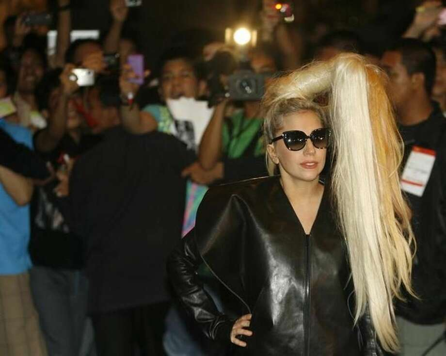 U.S. singer Lady Gaga poses for photographers upon arrival for her concert in Manila May 19, 2012. Photo: Cheryl Ravelo — Reuters