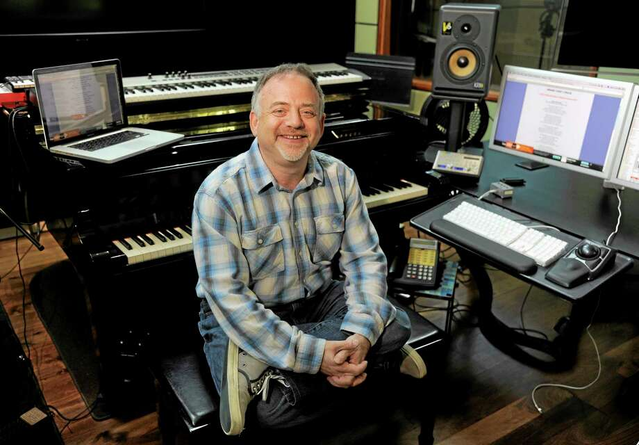 """In thsi Wednesday, Aug. 14, 2013 photo, composer Marc Shaiman poses at his home recording studio in Los Angeles. Shaiman and partner Scott Wittman are nominated for an Emmy for their song, """"Hang the Moon,"""" from TV's """"Smash.""""  Their latest stage musical, """"Charlie and the Chocolate Factory,"""" is a hit on London's West End. (Photo by Chris Pizzello/Invision/AP) Photo: Chris Pizzello/Invision/AP / Invision"""